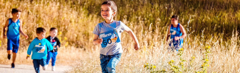 Boy running on walkway