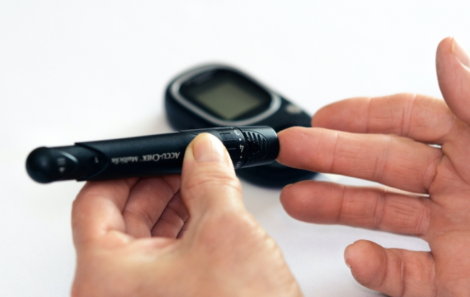 Black glucometer in use by patient