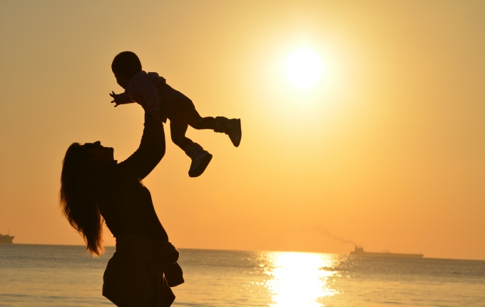 Mother holding baby in air