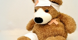 Teddy bear with injuries