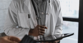 Medical professional holding a tablet