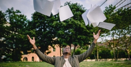 Person throwing papers in the air in celebration