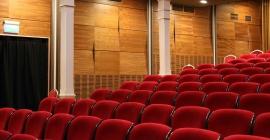 Red auditorium seats with rustic design