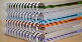 Stack of spiral-bound notebooks