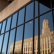 Cathedral and Hillman Library reflecting in Wesley W. Posvar Hall windows